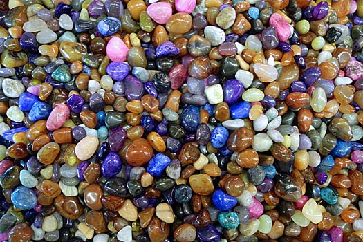 How to Avoid The Most Common Travel Scams: Gemstones might just be polished glass. Photo by Woody Hibbard