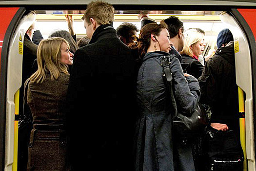 How to Avoid The Most Common Travel Scams: Busy trains are a pickpocket's dream. Photo by Ted Sullivan